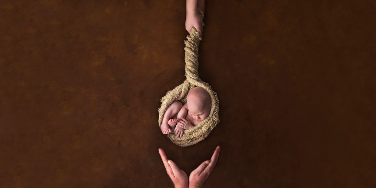 cute baby in a hanging basket